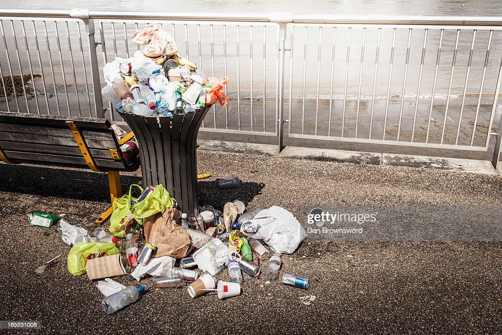 Trash overflowing from bin