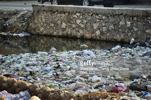 Trash pile in an Egyptian canal : Stock Photo