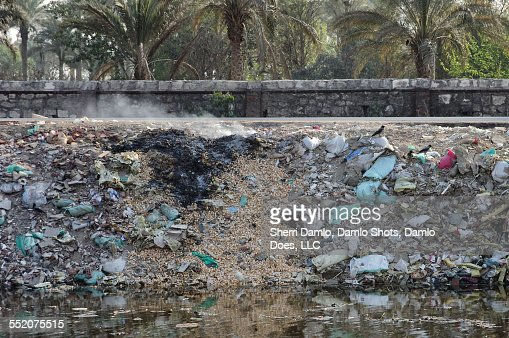 Trash pile on fire in Cairo