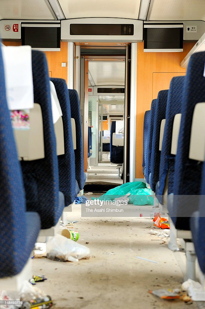 Trash remain as they are in the crashed bullet train carriage, that had left at the yard near the accident site where two Chinese bullet trains collided and killed more than 40 passengers and 200 injured, on July 13, 2012 in Wenzhou, Zhejiang Province, China. The wreckage of the crashed train were removed and the land where authority had hidden the carriage had been leveled.