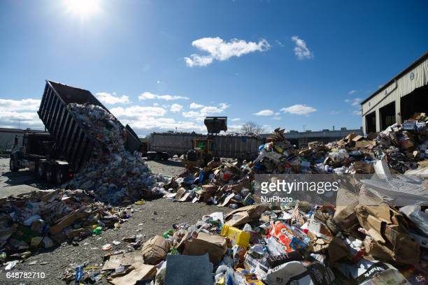 Trash truck tips its load of Municipal rubbish from a Philadelphia suburb at the yard outside the Materials Recovery Facility in South Philadelphia...