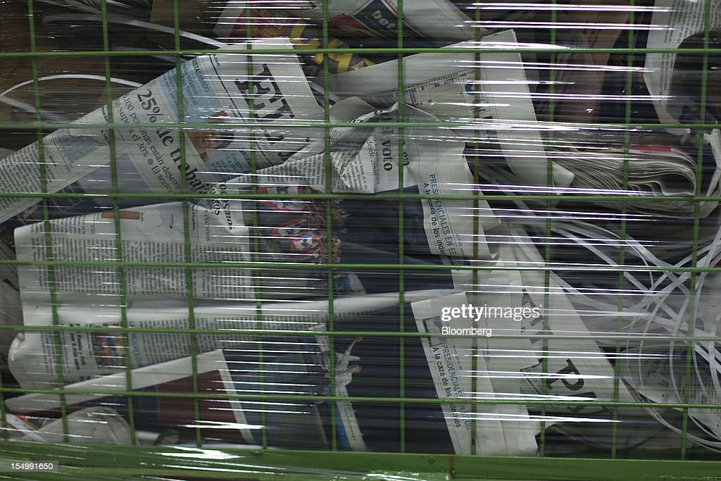 Trashed copies of recently printed El Pais newspapers lie in a basket at the El Pais printing plant in Madrid, Spain, on Tuesday, Oct. 30, 2012. Prisa, the publisher of El Pais newspaper, has announced staff reductions and salary cuts. Photographer: Angel Navarrete/Bloomberg via Getty Images
