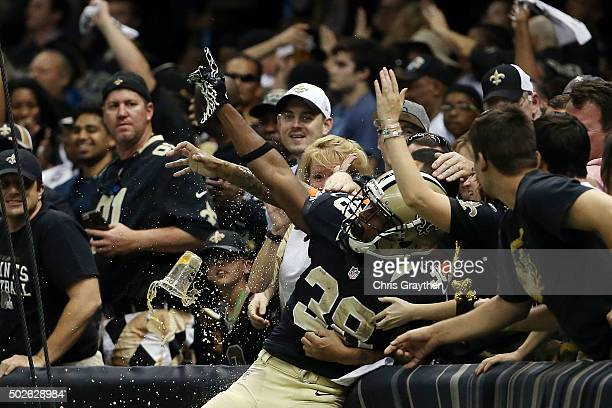 Travaris Cadet of the New Orleans Saints celebrates a touchdown with fans during the third quarter of a game against the Jacksonville Jaguars at the...