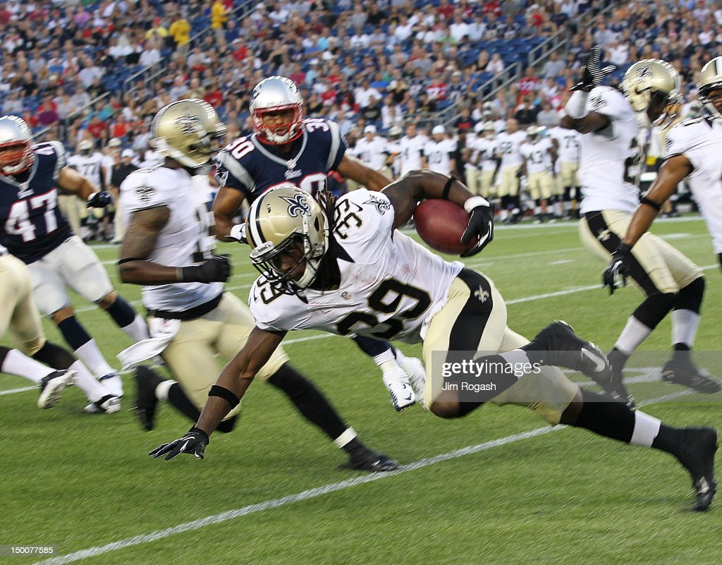 Travaris Cadet #39 of the New Orleans Saints gains yardage during a game against the New England Patriots in the first half at Gillette Stadium on August 9, 2012 in Foxboro, Massachusetts.