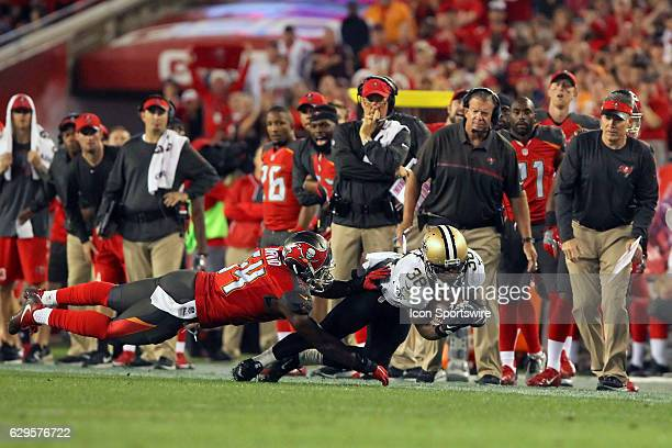 Travaris Cadet of the Saints makes a tough toe tapping catch along the Buccaneers sideline as Lavonte David of the Buccaneers defends on the play...