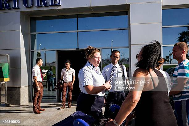 Travco representative helps stranded tourists outside the airport terminal get information on a flight on November 05 2015 in Sharm ElSheikh Egypt If...