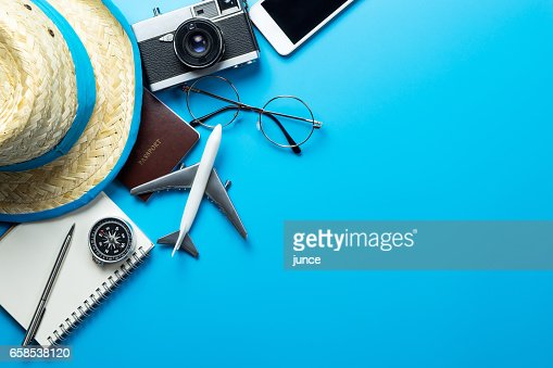 Travel accessories with copy space on blue background : Stock Photo