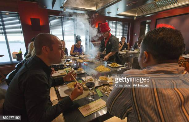 Travel agents try out the Teppanyaki restaurant on board Norwegian Cruise Line's new ship the 146600 tonne Norwegian Breakaway
