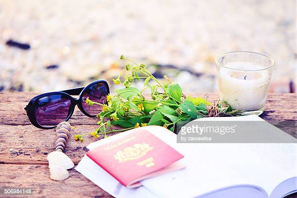 Travel And Spa Concept,Passport With Book And Glasses At Beach.