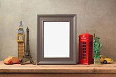Travel and tourism concept with photo frame and souvenirs from around the world