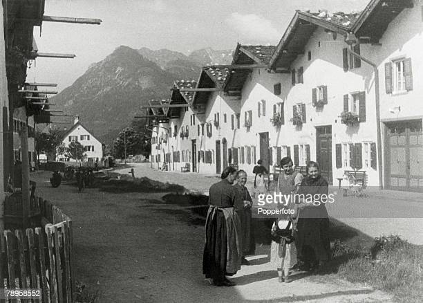 circa 1920 A street scene in Mittenwald with local women chatting with a young girl