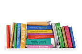 A variety of books with a Worldwide travel theme. All titles are mockups.