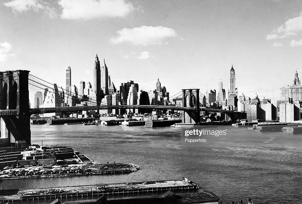 circa 1930's,The Brooklyn Bridge, New York, with the Manhattan skyline in the background