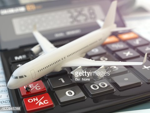 Travel cost calculation concept. Airplane and calculator. Cheape : Stock Photo