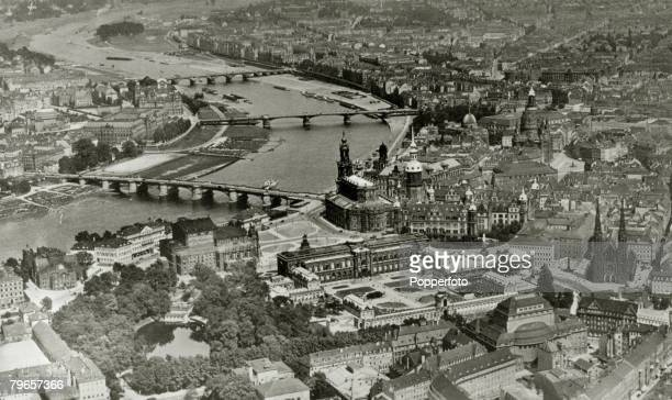 circa 1930 Dresden an aerial viewshowing the Alstadt the Zwinger Opera House Hofkirche and Augustus Brucke Carola Brucke and Albert Brucke over the...