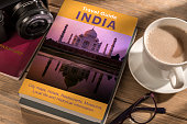 Travel Guide to India on the table. Photographer's own book cover design.