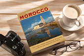 Travel Guide to Morocco on the table.