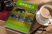 Travel Guide to Africa on the table. Photographer's own book cover design.