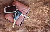 Travel Holiday with car keys and wallet on the wooden table. copy space.