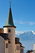 Heritage building in Montreux old town area and French Alps in background