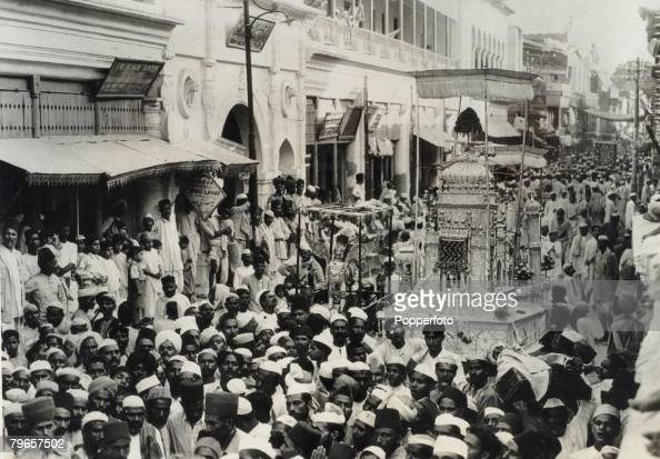 Travel Lucknow India Circa 1900's The Mohurram Festival The annual procession passing through the crowded streets In the foreground decorated taziyas...