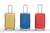 gold, red and blue luggages on white background
