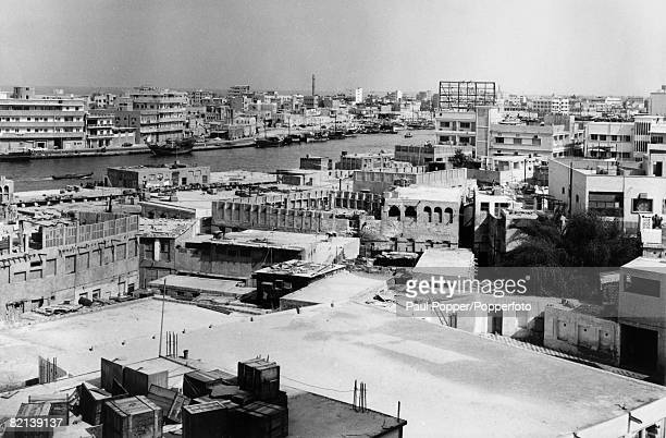 circa 1960's Dubai a general view showing buildings and boats in the harbour