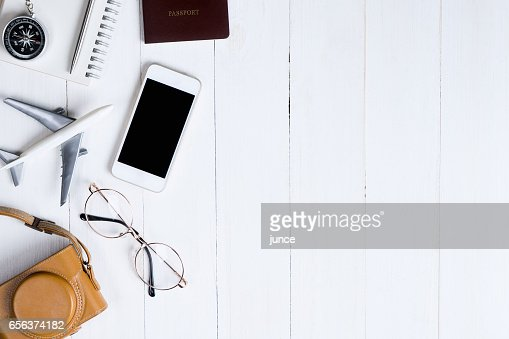 Travel objects flatlay on white wooden with copy space : Stock Photo