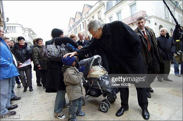 Travel of Dominique de Villepin accompanied by Francois Mayor of Troyes and Minister of Overseas in Troyes France on February 03 2006 Visiting the...