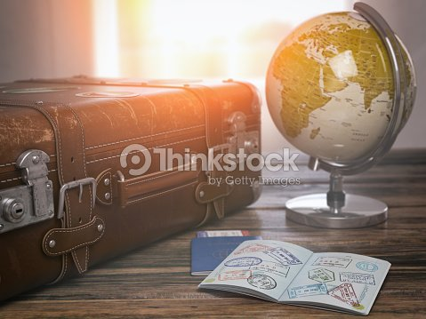 Travel or turism concept.  Old  suitcase  with open passport with visa stamps and globe. : Stock Photo