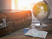 Travel or turism concept.  Old  suitcase  with open passport with visa stamps and globe. 3d illustration Map of the world invidually drawn in Adobe Illustrator and have own outline.  It was generated