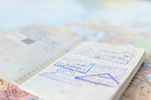 Travel plan concept and preparing to travel , Passport , money, telephone on world map background (Selective Focus)