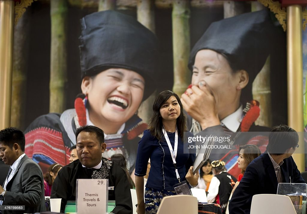 Travel professionals are pictured at the Myanmar stand at the ITB International Travel Trade Fair in Berlin March 5, 2014. The ITB opens from March 5 to 9, 2014.