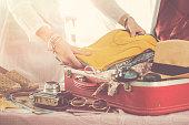 Travel suitcase prepareing concept