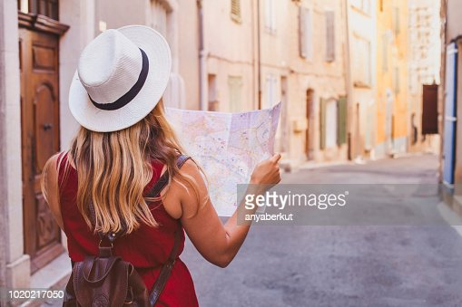 travel to Europe, tourist looking at map on the street, summer holidays : Stock Photo