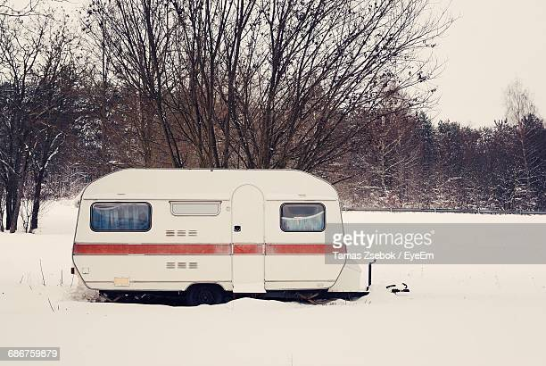 Travel Trailer On Snow Covered Field