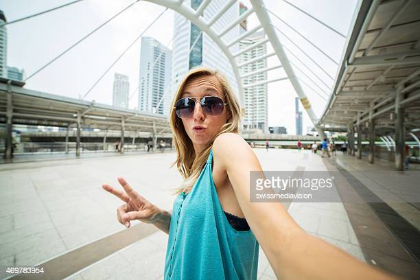 Travel woman in Bangkok taking selfie