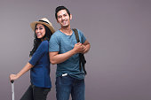 Traveler asian couple with happy expression over bright background