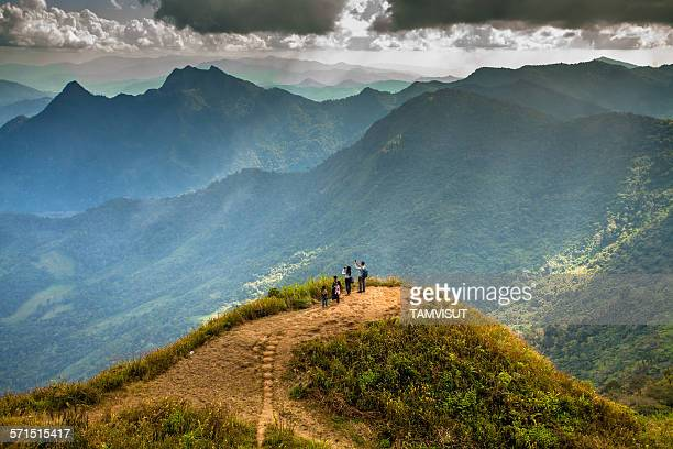 Traveler at peak of mountain in north of Thailand