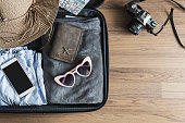 Traveler baggage with clothes and accessories, Travel vacation trip concept