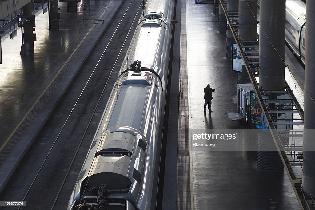 A traveler checks his watch on an empty platform beside a high speed train at Atocha railway station on the morning of a general strike in Madrid, Spain, on Wednesday, Nov. 14, 2012. Spanish unions today staged their second general strike against Prime Minister Mariano Rajoy as mounting opposition to budget cuts and bank bailouts undermines the 11-month-old government's ability to repair the economy. Photographer: Angel Navarrete/Bloomberg via Getty Images