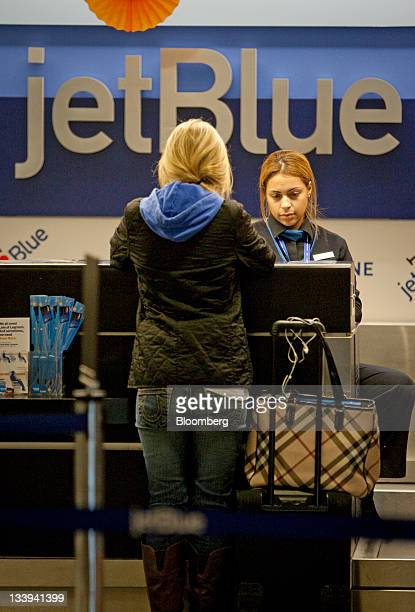A traveler checks in at a JetBlue Airways Corp counter at LaGuardia airport in New York US on Tuesday Nov 22 2011 US travel during the Thanksgiving...
