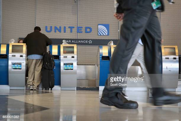 A traveler checks in for flights at O'Hare International Airport on March 14 2017 in Chicago Illinois Activity at the airport was light after many...