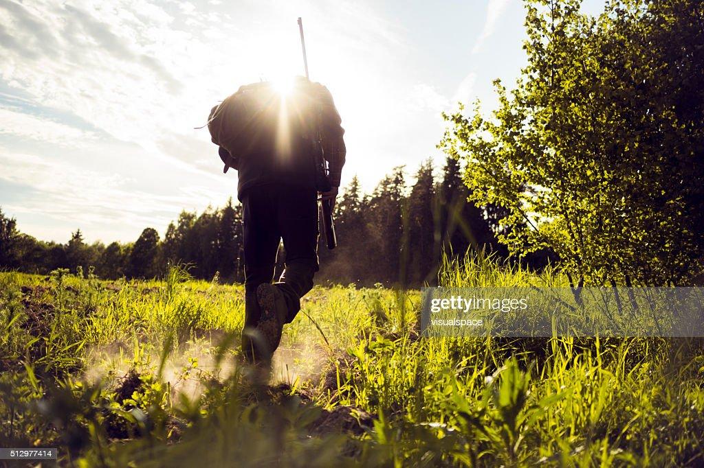Traveler Hiking Walking Over A Grassland