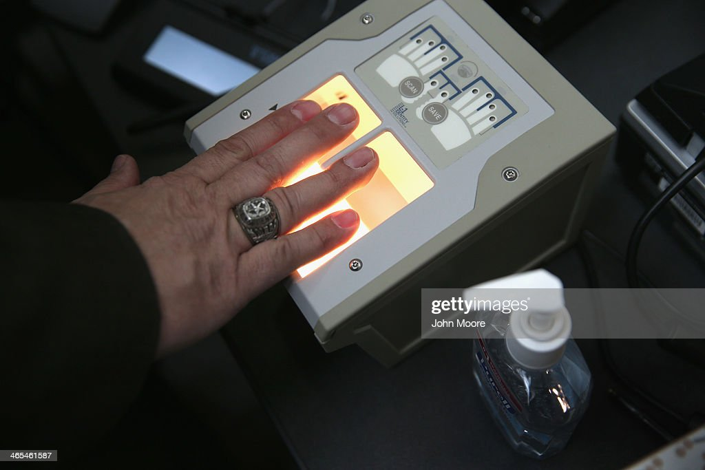 A traveler is fingerprinted while enrolling at a newly-opened TSA Pre-check application center at LaGuardia Airport on January 27, 2014 in New York City. Once approved for the program, travelers can use special expidited Precheck security lanes. They can also leave on their shoes, light outerwear and belt, as well as keep their laptop and small containers of liquids inside carry-on luggage during security screening. The TSA plans to open more than 300 application centers across the country.