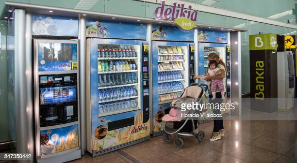 A traveler is seen using one of Delikia food and beverages dispensers in Terminal 1 of Barcelona'u2013El Prat Airport on September 10 2017 in...