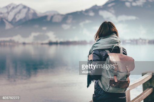 Traveler looks at landscape : Stock Photo