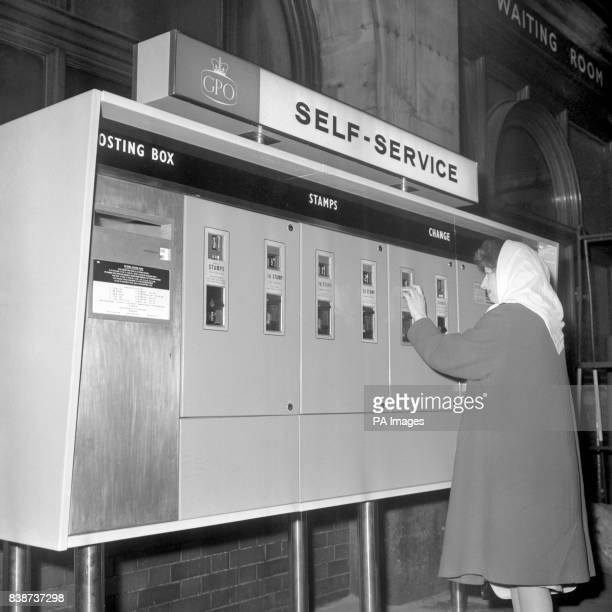 A traveler makes a purchase from the new selfservice kiosk set up by the Post Office as an experiment at Victoria Station London The machine sells...