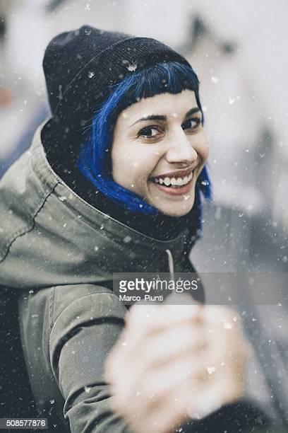 Traveler man follows a woman under the snow