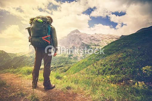 51dcf6ca62a6 Traveler Man with big backpack mountaineering Travel Lifestyle concept    Stock Photo